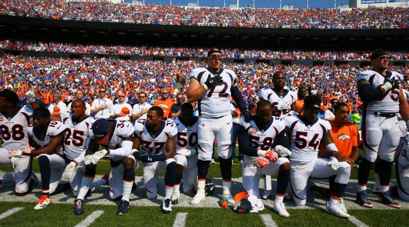 broncos-players-kneel.jpg